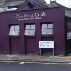 Photo taken at Konditor & Cook Ltd by Julian H. on 7/16/2012