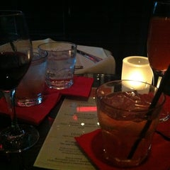 Photo taken at Christophers Restaurant & Crush Lounge by Rebecca S. on 4/7/2012