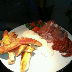 Photo taken at Pizza Express by Juliet C. on 11/1/2011