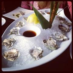Photo taken at Takayama Sushi Lounge by Mike R. on 6/29/2012