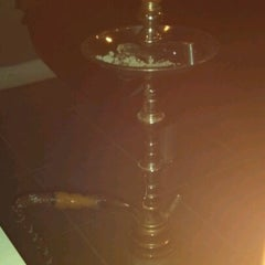 Photo taken at Mist Hookah Lounge by Mariana R. on 6/12/2012