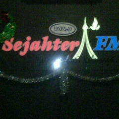 Photo taken at Sejahtera 107.3 FM by Gus T. on 12/21/2011