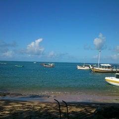 Photo taken at Praia do Forte by Wladimir D. on 7/14/2012