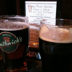Photo taken at Brocach Irish Pub on the Square by Theresa S. on 2/26/2012