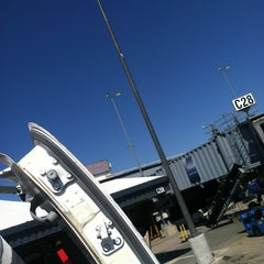 Photo taken at Gate C28 by Levi F. on 4/3/2012