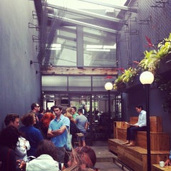 Photo taken at Intelligentsia Coffee & Tea by Eric I. on 7/14/2012