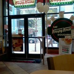 Photo taken at Krispy Kreme Doughnuts by Nikki M. on 11/1/2012