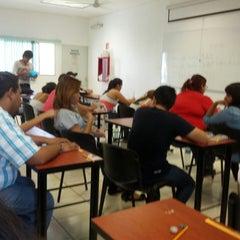 Photo taken at Facultad de Letras y Comunicación by Jonathan L. on 5/9/2014