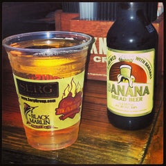 Photo taken at The Lodge Beer and Growler Bar by Janet C. on 3/2/2013