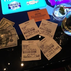 Photo taken at The Mirage Race & Sports Book by Stacy C. on 11/4/2015