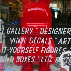 Photo taken at Outland Designer Toy Store & Art Gallery by Bennie K. on 10/12/2013