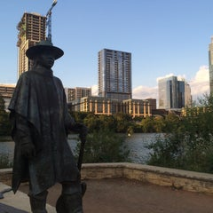 Photo taken at Stevie Ray Vaughan Statue by Felipe P. on 9/1/2015