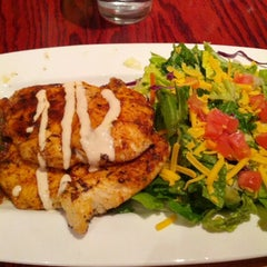 Photo taken at Red Robin Gourmet Burgers by Eddie S. on 1/19/2013