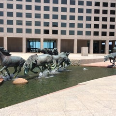 Photo taken at The Mustangs of Las Colinas by Lucas P. on 8/13/2014