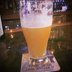 Photo taken at Hooligan's Pub by Joe G. on 4/15/2015