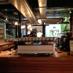 Photo taken at Workshop Coffee Co. by Grace K. on 4/12/2013