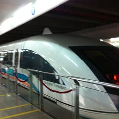 Photo taken at 磁悬浮龙阳路站 Maglev Train Longyang Road Station by Karen B. on 11/2/2012