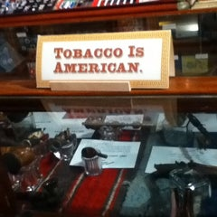 Photo taken at Racine & Larame Cigar Shop by Jonathan J. on 12/17/2012