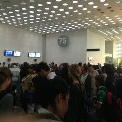 Photo taken at Sala/Gate 75 by Alejandro B. on 1/5/2013