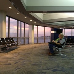 Photo taken at General Mitchell International Airport (MKE) by Jason T. on 10/2/2012