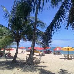 Photo taken at Praia de Itapuã by Thiago T. on 10/23/2012