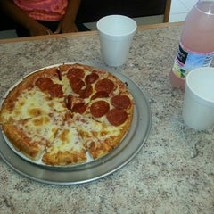 Photo taken at Old Country Pizzeria by Mic E. on 6/30/2015