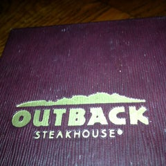 Photo taken at Outback Steakhouse by Erica M. on 12/16/2012