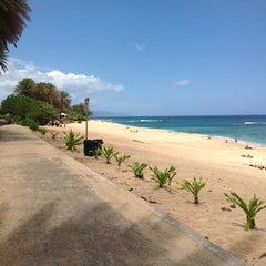 Photo taken at Ehukai Beach by Masahiro F. on 5/17/2013