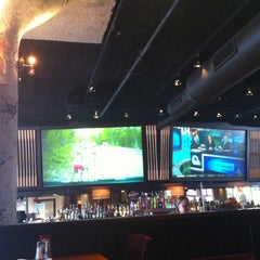 Photo taken at Jerry Remy's Sports Bar & Grill by Carmen G. on 7/14/2013
