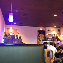 Photo taken at Ginger Asian Cuisine & Sushi Bar by Paws M. on 12/21/2012