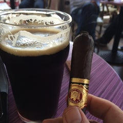 Photo taken at Churchill's Cigar Lounge by Ken N. on 3/21/2014