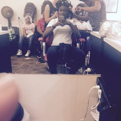 Photo taken at Dominican Hair Salon by tamoya r. on 5/2/2015