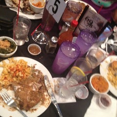 Photo taken at 6978 Soul Food by Tramaine L. on 4/18/2015