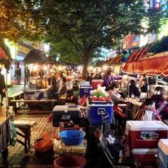 Photo taken at BIFF 광장 (BIFF Square) by Jason P. on 10/13/2012