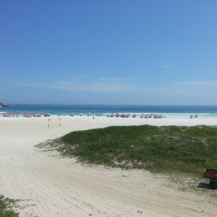 Photo taken at Praia Grande by Jocasta I. on 3/8/2013
