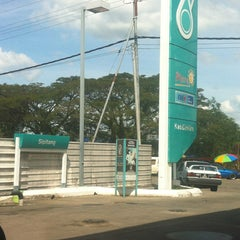 Photo taken at Petronas by Shah D. on 12/25/2012