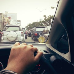 Photo taken at Jalan Margonda Raya by olive t. on 3/14/2015