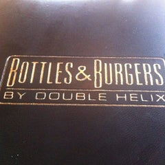Photo taken at Bottles & Burgers By Double Helix by Vino Las Vegas on 12/16/2012