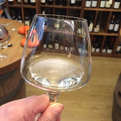 Photo taken at Loki Wine Merchant & Tasting House by Liz G. on 1/3/2015