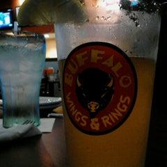 Photo taken at Buffalo Wings & Rings by Sara V. on 6/15/2012