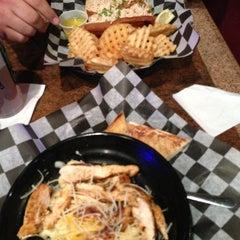 Photo taken at Deep Deuce Grill by Cynthia N. on 4/11/2013