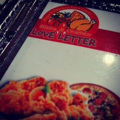 Photo taken at Pizza & Chicken Love Letter by Sean B. on 11/4/2012