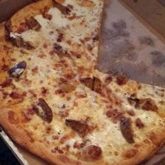 Photo taken at The Wild Tomato Pizzeria by Matt N. on 3/15/2014