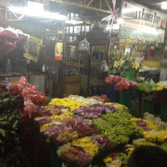 Photo taken at Dangwa Flower Market by Mariane D. on 4/1/2013