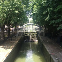 Photo taken at Canal Saint-Martin by Isabelle S. on 6/30/2013