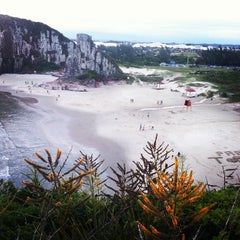 Photo taken at Praia da Guarita by Sualter H. on 1/18/2013