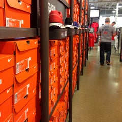Photo taken at Nike Factory Store by Rick W. on 4/19/2015