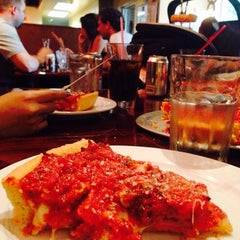 Photo taken at Kylie's Chicago Pizza by Mario R. on 9/15/2014