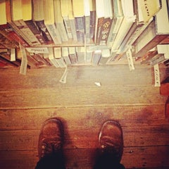 Photo taken at Sappho Books, Cafe & Wine Bar by Ronaldy P. on 5/18/2013