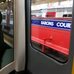 Photo taken at Barons Court London Underground Station by Olivier O. on 6/16/2013